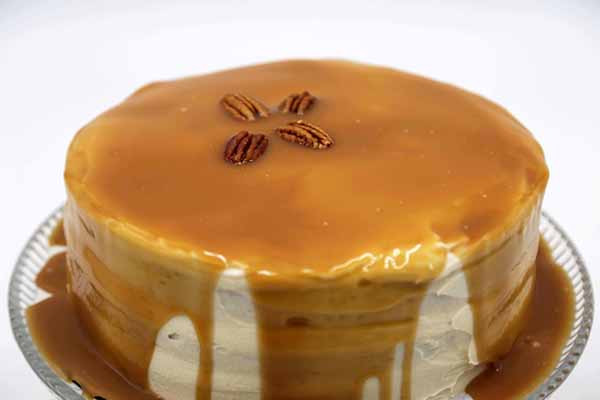 Salted Caramel drizzled over Sweet Potato Cake w/ Praline Filling